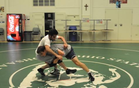 Alibrando Petrini '11 and Camron Tarassoly '11 are working hard on their double-leg takedowns