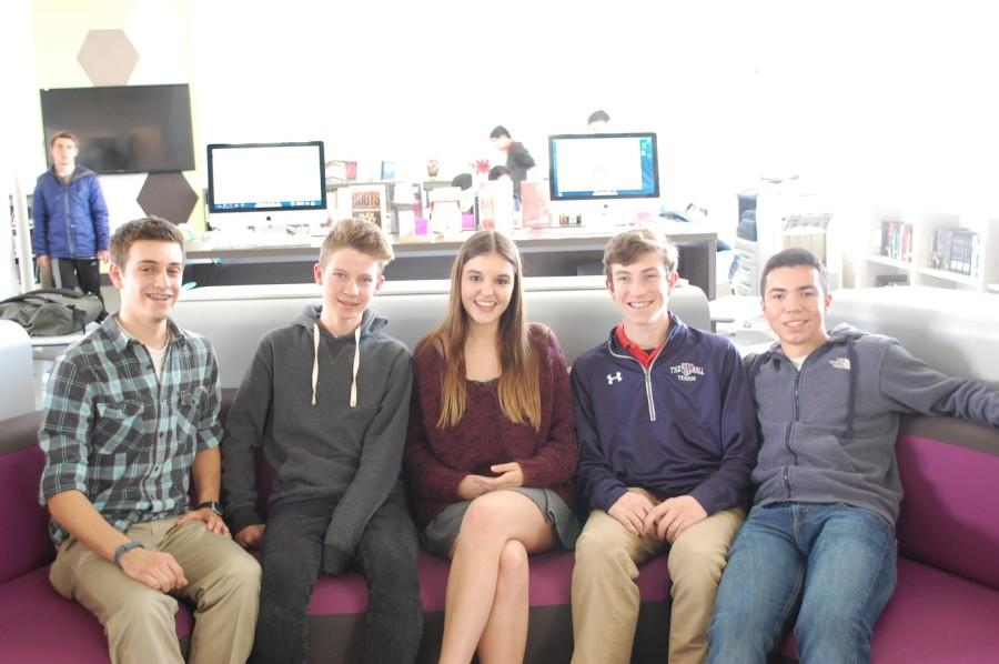 Stuart Hall hosts pose for a photo with their guests in the Learning Commons.