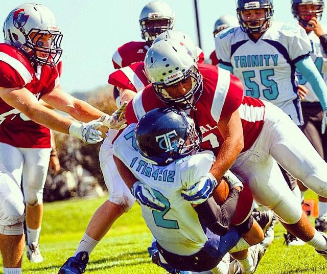 Omid Ravanfar '16 makes a tackle in last year's Homecoming game against Trinity Christian.
