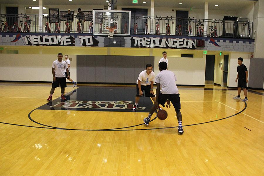 Jeremiah Sullivan '17 sizes up Angel Padilla '18 in a competitive intramural game this week.