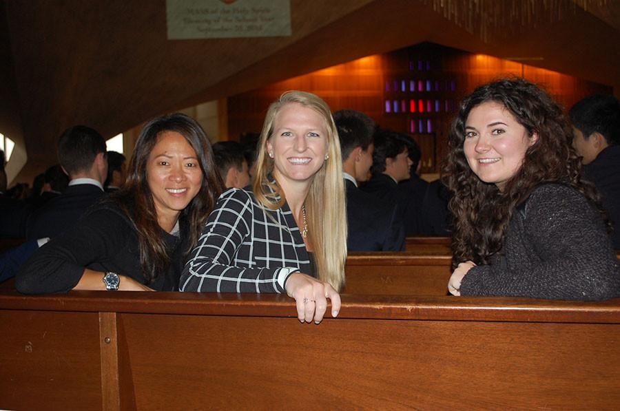 Ms. Chuakay, Ms. Peterson, and Ms. MacGarva pose for a photo while waiting for the mass to commence.