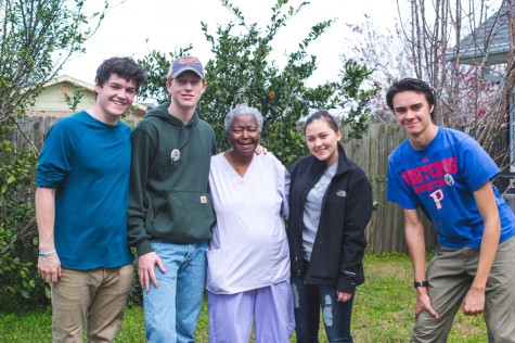 Stuart Hall & Convent students pose with residents in New Orleans.