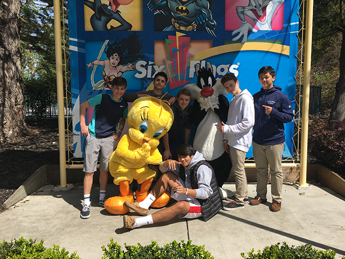 The lacrosse team takes a pic with mascots at Six Flags: Discovery Kingdom before leaving early for their game against Sonoma Academy.