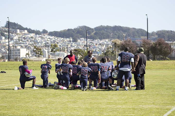 The Knights football team huddles up prior to the Homecoming game on Oct. 1. The Knights won its second straight league championship this season after finshing 5-0 in league play and 5-2 overall. Stuart Hall conceded the least amount of points in its league, and are looking to return many junior defensemen for a run at a third straight championship next year.