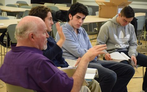 Nicholas Camminante '18 and Seth Eislund '18 listen to Norm Luna give stage directions at rehearsal on Monday. The class meets during H periods every week to work on their performance.