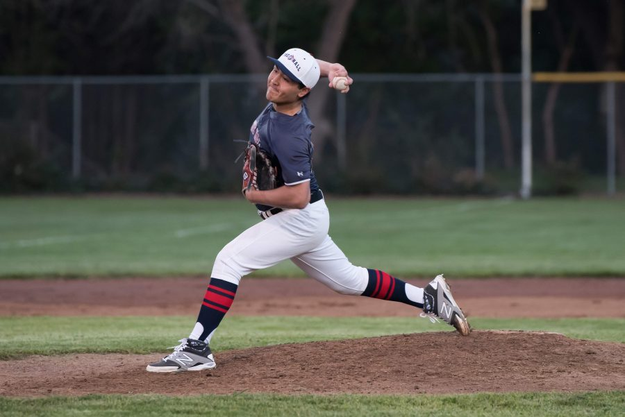 Achilles+Arnold+%2717+delivers+a+pitch+during+Friday+night%27s+game+versus+Sonoma+Academy.+Arnold+pitched+four+innings+and+received+the+win+with+seven+strikeouts+and+only+two+earned+runs.
