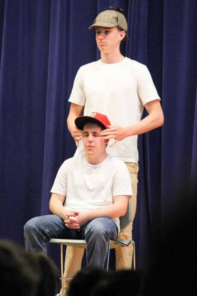 John Abbot '18 plays Sherlock Holmes massages his assistant John Watson played by Seth Eislund '18. More than one student played these roles.