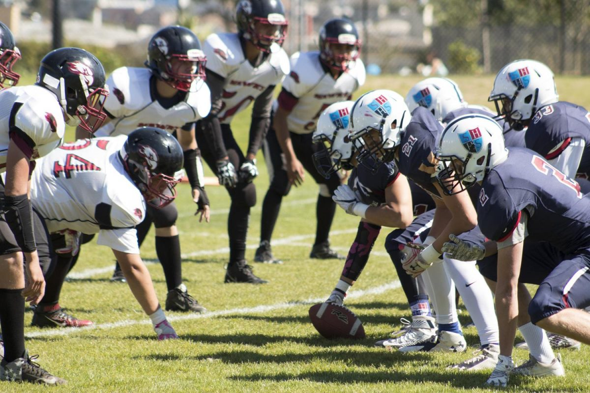 The Hall lines up on the line of scrimmage during the Homecoming game at Boxer Stadium. The team is in action again next week against Tomales on Friday at 7 p.m. in San Juan Bautista.