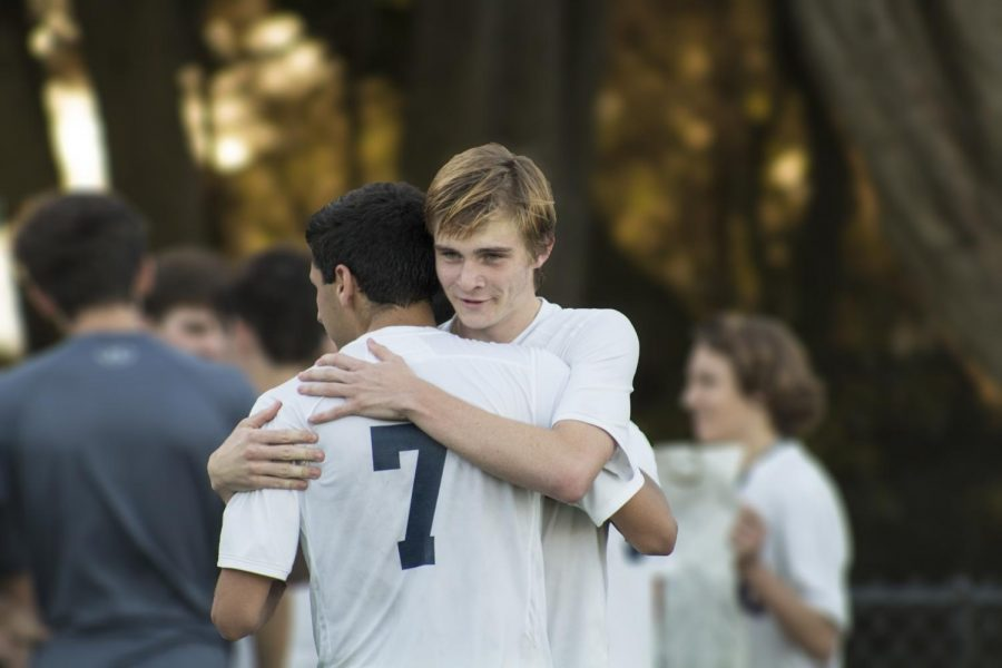 Freddy Kiaie '18 (near) hugs Jack Honeyman '19 following the Knights 4-0 loss to Urban last Friday at Beach Chalet. The Knights finished the regular season with a record of 9-2-3.
