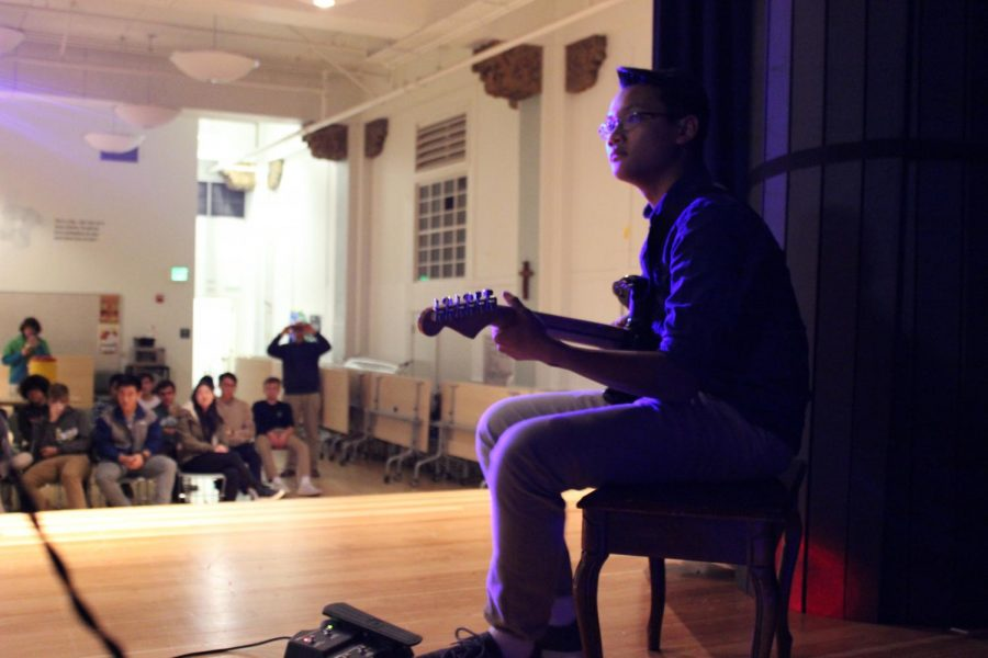 Randy Dumalig '18 performs at the SIA benefit concert which was held on Dec. 1 to raise money for the victims of the California fires. The concert was just one of many ways that SIA tries to help others around the holidays.