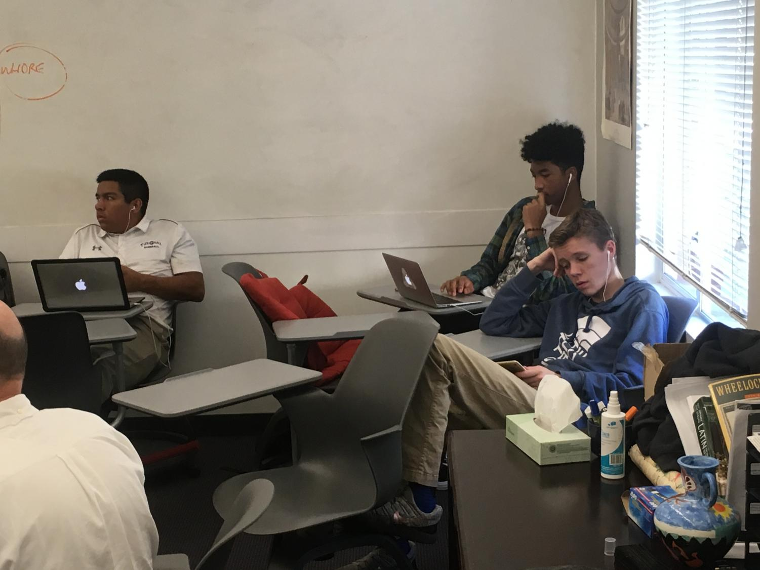 Seniors relax in class following the completion of an assignment. Teachers and administrators feel that it is the responsibility of seniors to ensure that they stay engaged in class.