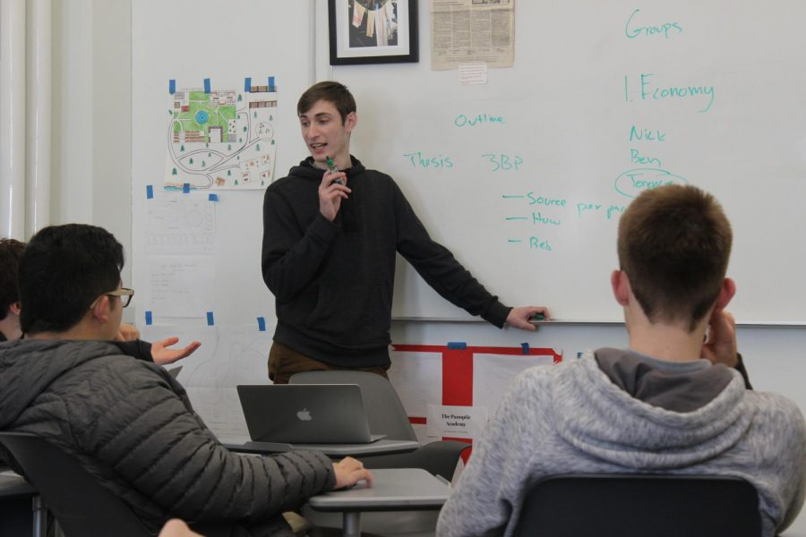 Jason Arzhintar '19 teaches during the Theory of Knowledge class. Arzhintar and his classmates have started a club to bring attention to events that have fallen out of the news cycle or not received wide media attention.