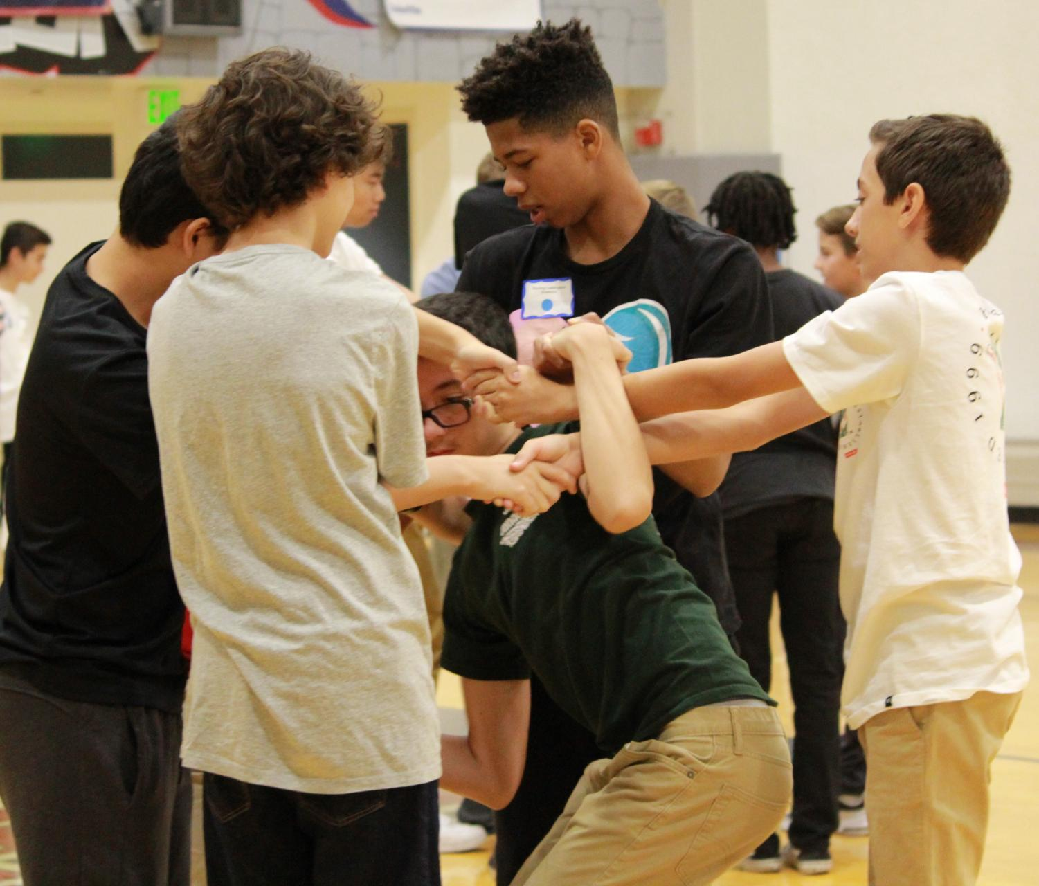 Ninth graders play a game of human knot during Freshman Success Aug. 15. Orientation took place on both campuses over a period of two days and also served as a social opportunity