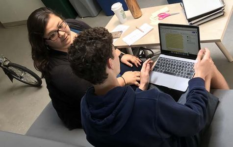 Elena Wong, an admissions department representative from Drew University, gives senior Kyle Jasper feedback on his CommonApp essay. Ten university representatives helped seniors begin their college application process during last week's workshop.