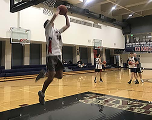 Junior Mac Hatfield shoots a reverse layup during practice in The Dungeon. The Knights began the season without power forward Nigel Burris, who transferred to Archbishop Mitty High School.