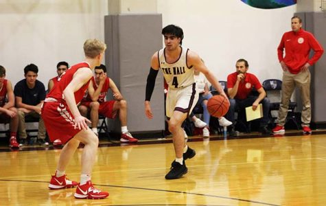 Senior Tomas Wolber gets ready to drive to the basket at Stuart Hall's home game against University High School on Jan. 14. Wolber committed to Linfield College's team in late April.