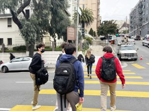 Sophomore Lev Cohen and juniors Will White and Ben Rinehart walk past the St. Benedict Parish for the Deaf on their way to the Broadway campus. Stuart Hall students and faculty primarily on the Pine/Octavia campus used to gather in the parish every other week for Chapel, but gatherings have been occurring virtually since March 2020.