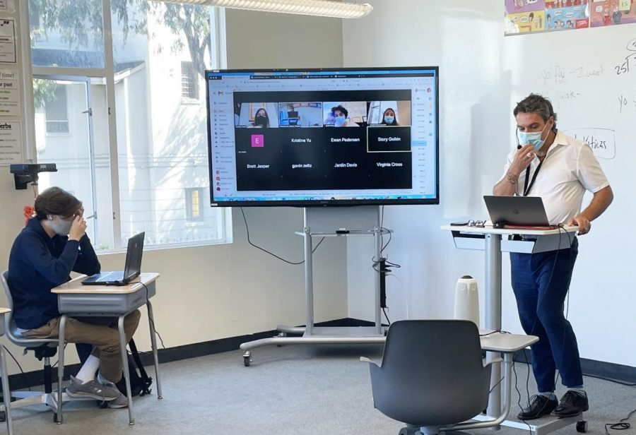 Spanish teacher Francisco Teixeira uses a Meeting Owl camera in a class to help students engage in both in-person and virtual instruction. The cameras come with speakers and microphones so that students could see and hear one another in a hybrid learning environment.
