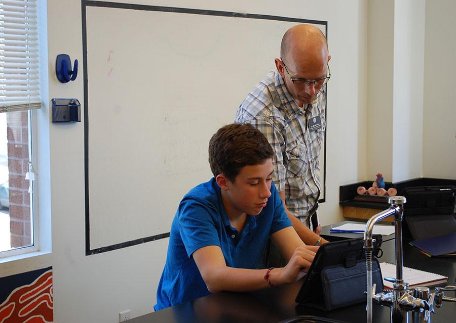 Dr. Weirs helps a student during a freshman biology class.
