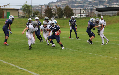 <B> Omid Ravanfar carries the ball in a game at Boxer Stadium earlier this year. </B>