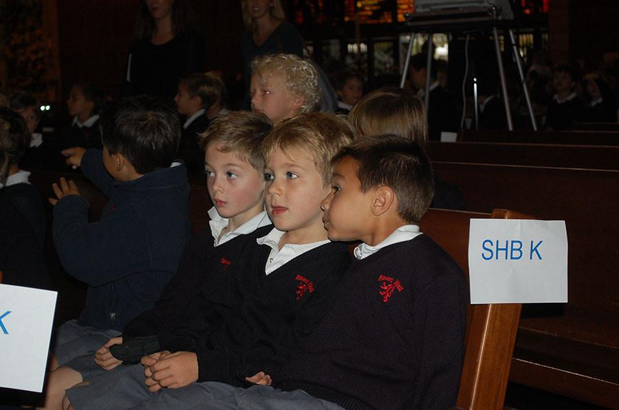 Stuart Hall for Boy's students wait for the mass to start.