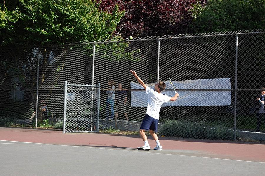Harry Doyle serves the ball in a game against University.