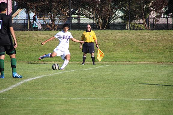 Emilio Lopez '17 clears the ball in a game last week. The Knights have few games left to move into playoff contention as the regular season comes to a close at the end of October.