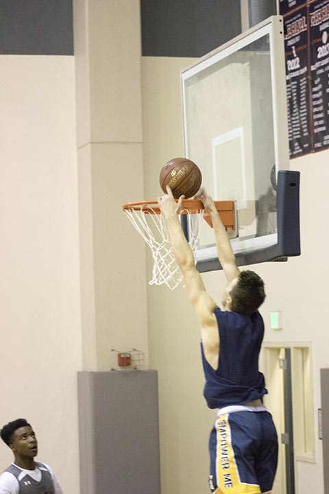 Sean Ingoglia '18 dunks at the Knights' first practice of the season on Monday. Varsity's first game is at St. Ignatius next Wednesday.