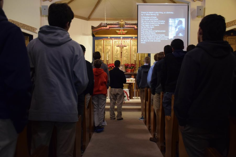 Several rows of students face towards the front of the chapel.