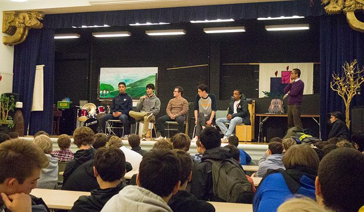Five+alumni+college+panelists+speak+to+students+during+assembly+on+Monday.+The+panel+is+an+annual+event+put+on+by+the+College+Counseling+office.+
