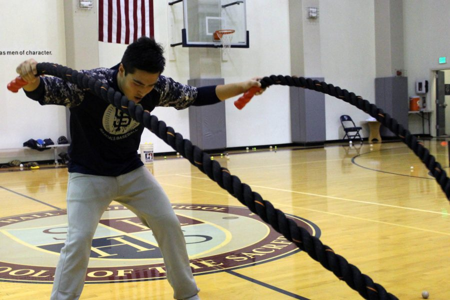 Achilles Arnold '17 works out during baseball practice in The Dungeon. The baseball team was forced to hold their first week of practice indoors as a result of the weather.
