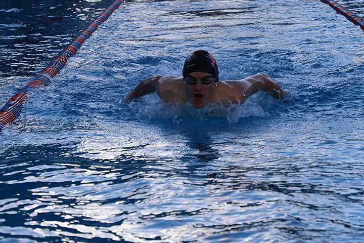 Jack Merrigan '17 finishes an event at a recent swim meet. The Knights lost to Bentley and Drew by scores of 94-49 and 68-62, respectively.