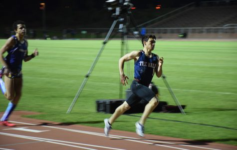 Elijah Horowitz '17 leads the pack during an event at the Sunset Invitational. Horowitz, a leader on the track and field team, has competed in events across California this year.