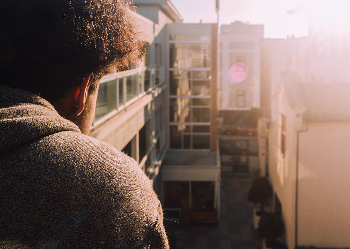 Jaden Newman '17 looks over the courtyard at Stuart Hall High School early on a  March morning. Newman has recently begun to release music online and is seeing increasing success.