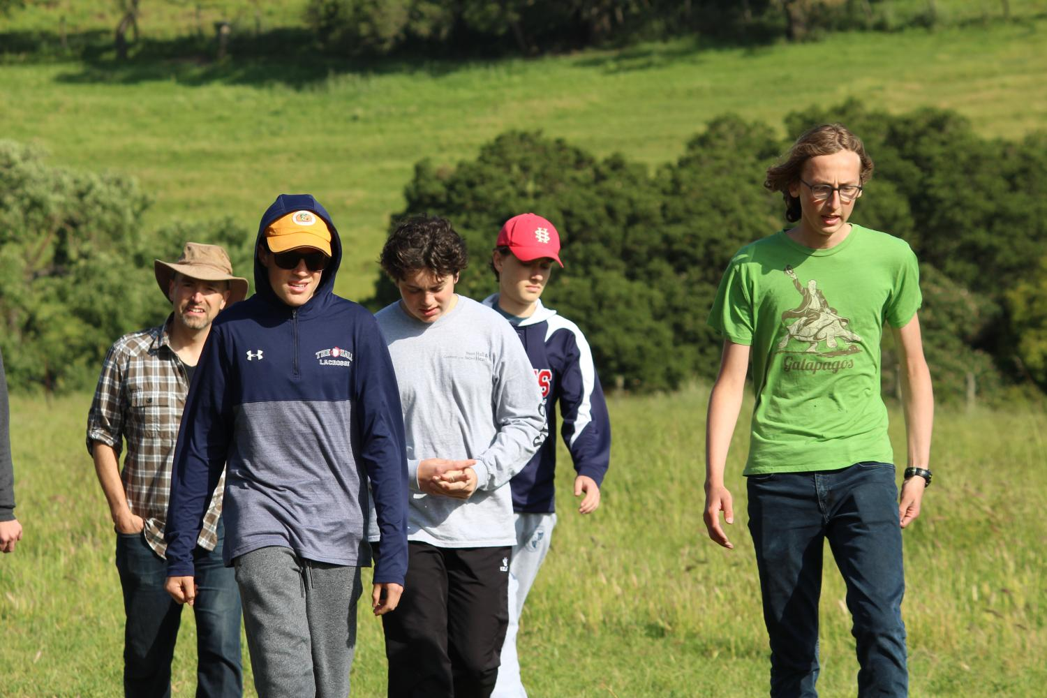 Theo Ennis '19 and Owen Murray '20 lead a group of meditators up a trail on the the Ennis family's property. The retreat took place last weekend and was the final retreat of the year.