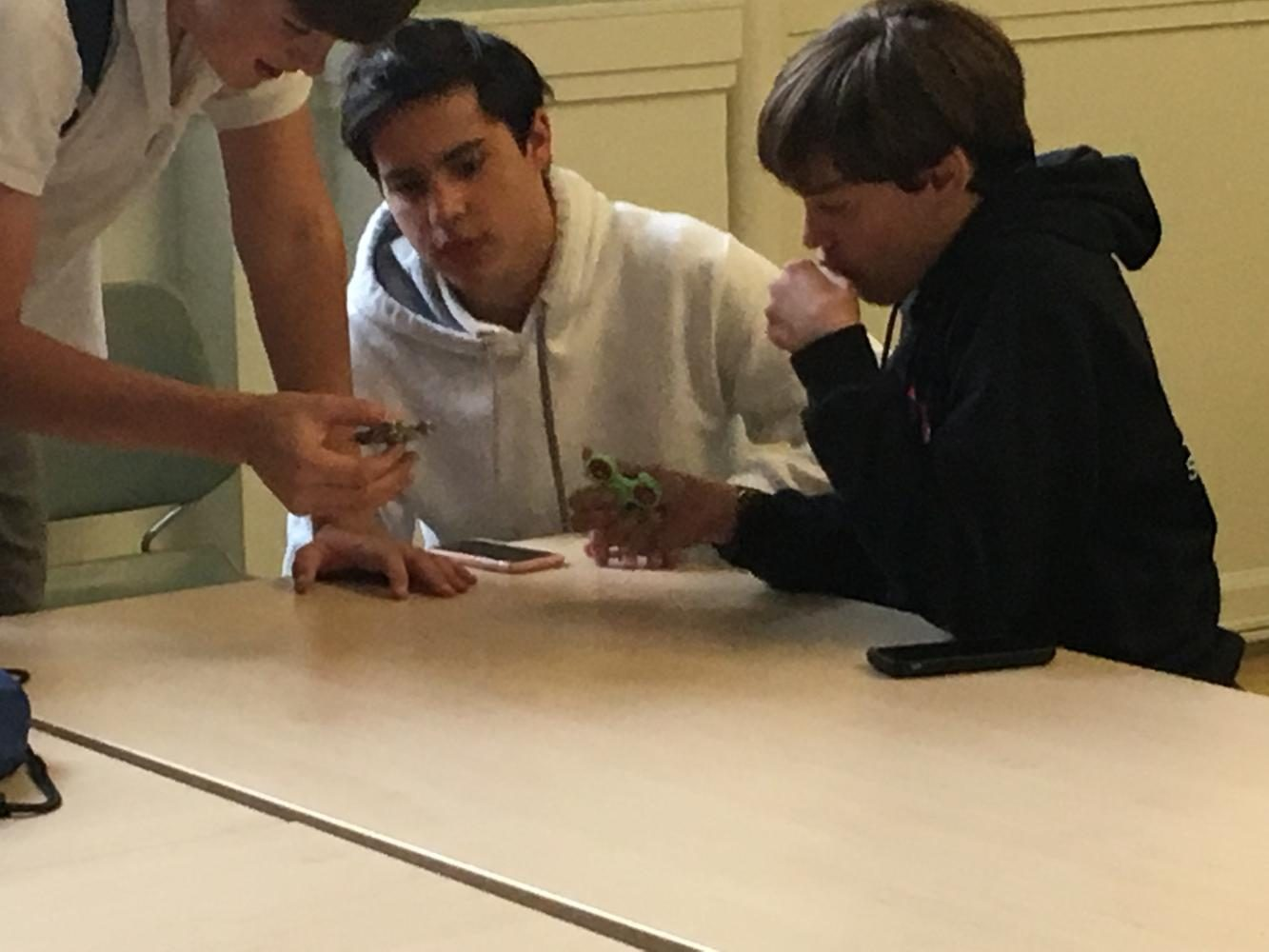 Student play with fidget toys during lunch. The toys have been beneficial for some students, but have also proven to be a distraction in the classroom.