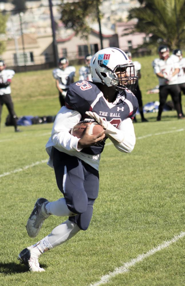Jorim Powell '18 rushes the ball during the Homecoming game on Saturday against the Anzar Eagles at Boxer Stadium.