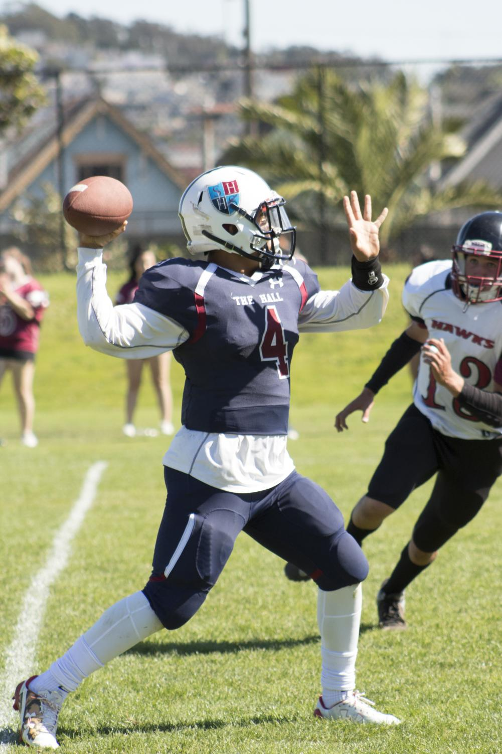 Jonathon Newsome '19 attempts a pass during a game earlier in the season.  Newsome started every game at quaterback for The Hall this season.