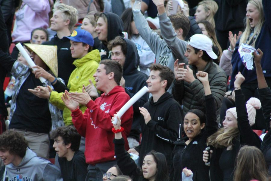 Students cheer for a touchdown. The Homecoming game draws football's largest crowd of the season.