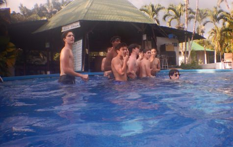 A group of sophomores prepare to play catch with a football at the Hotel Villas Rio Mar pool. After the morning activities, students ate lunch and had free time.