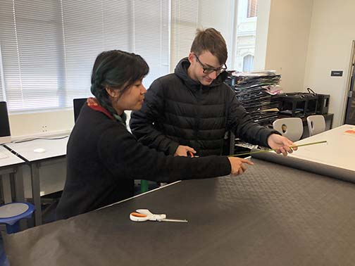 Art teacher Malisa Suchanya helps senior Xander Nuñez with a crafts project in the Art Studio. The art faculty informed students of the apprenticeship with Crucible instructor Brian Enright to encourage applied skills learning outside the classroom.