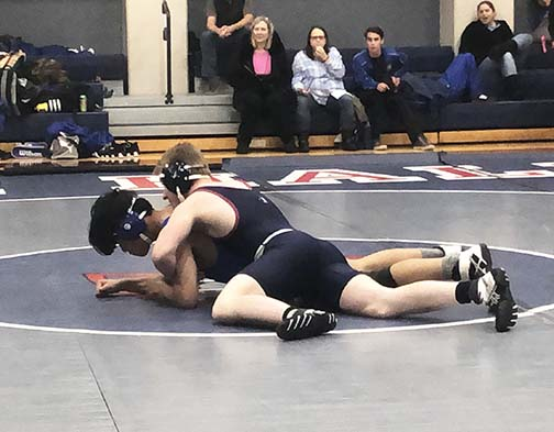 Captain Doug Dawkins wrestles with a Pinole Valley Spartan during a home match on Nov. 29. The Knights lost their first tournament of the season, but say they will focus on rebuilding the team by training promising underclassmen.