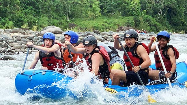 Will Burns, Will Yancey, James O'Leary, Toby Slater and Connor Caba paddle through a rapid with their guide. Sophomores descended to the river in a 30-minute shuttle ride before getting in rafts.