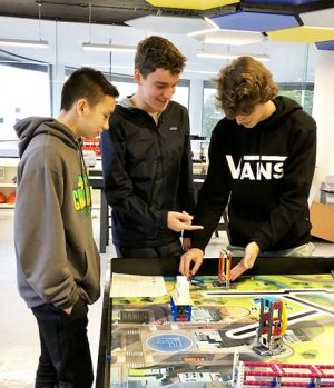 Juniors Trieu Tran, Chase Mack and Owen O'Dell build Lego robots in the robotics facility at Colegio Sagrado Corazon. Participants of the immersion trip met students and toured the campus during their visit to Convent & Stuart Hall's sister school in Mexico City.