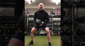 Coach makes daily workout videos during athletics suspension