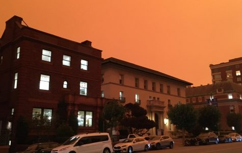An orange sky and darkness hover around the buildings of the Broadway Campus during the morning of Sept. 9. Smoke from fires burning across California combined with Bay Area fog, forming a dark, orange sky and forcing many students and faculty to keep their lights on during the day.