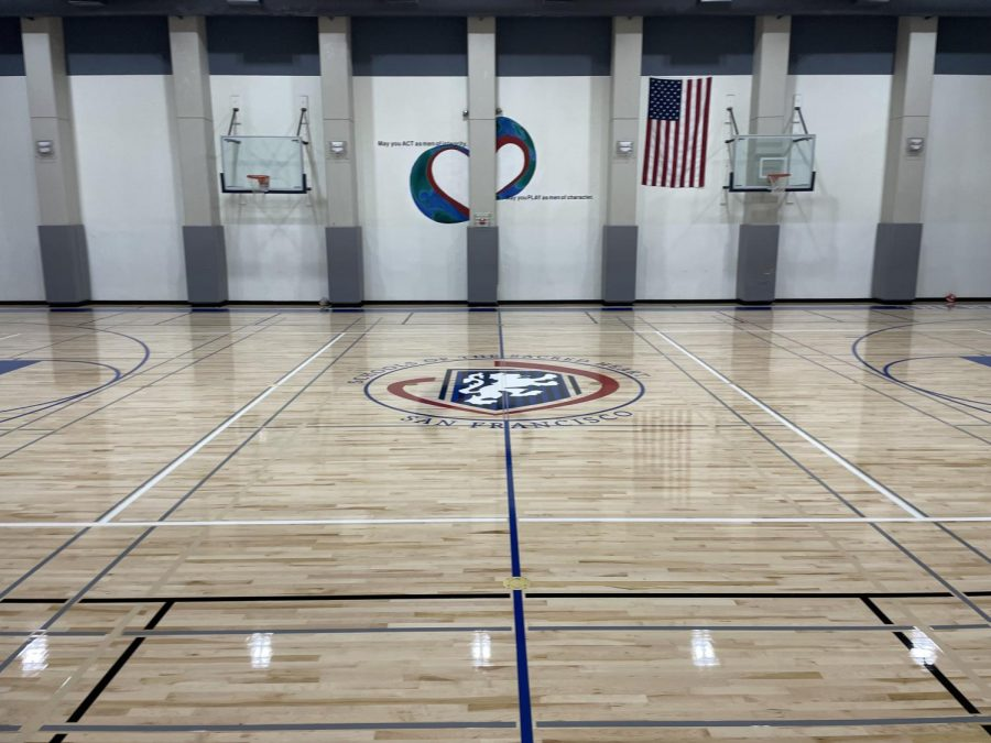 Four division Convent & Stuart Hall logo occupies the center of The Dungeon floor in place of the Stuart Hall High School shield. The school repainted the floor in addition to making maintenance changes and updates during the summer break.